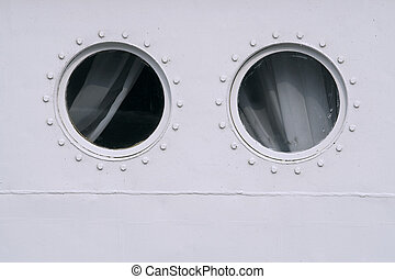 Porthole ship - Two portholes in the board passenger vessel....