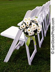 Guest Chairs for Outdoor Wedding - A bouquet of daisies...