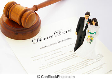 cake-topper wedding couple, divorce agreement and a gavel