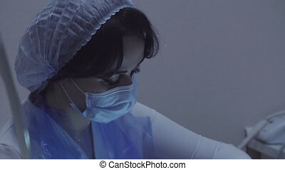 Woman dentist at work - Portrait of woman dentist at work