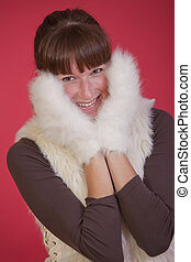 happy winter woman in gloves over red background