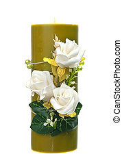 Large green candle with the flower decoration isolated on...