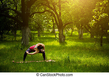 Young sportive woman standing in goddes yoga pose.