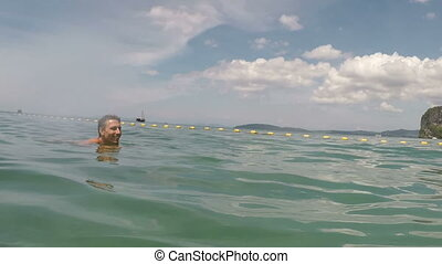 Happy Man Swimming In Sea Water Action Camera POV Of Young...