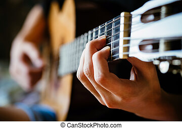 young musician playing acoustic guitar, live music...