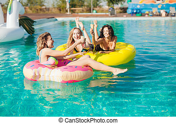 Friends in sunglasses eating ice cream at the pool. 20s. -...