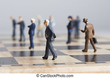 Business figurines and chessboard - Business figurines...