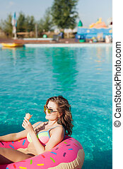 sexy girl in sunglasses eating ice cream in pool 20s. - sexy...