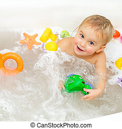 Bathing Baby  - Cute little girl bathing with toys