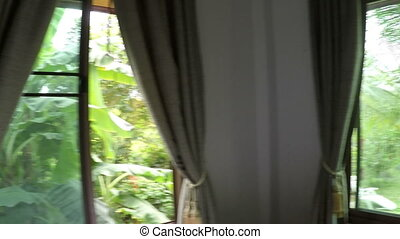 POV Of Man Waking Up In Morning Walking To Open Window Looking At Landscape Of Garden