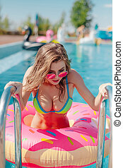 Portrait of attractive woman going out from swimming pool 20s.