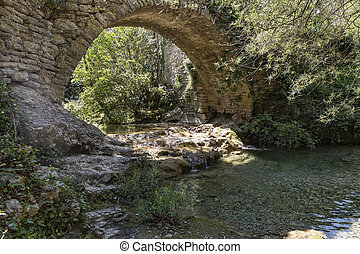 Old stone bridge in the village of Rochecolombe, Ardeche...