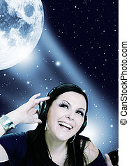 woman listening music in the moon light - smiling young...
