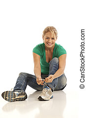 Woman tying shoe
