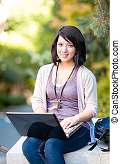 Mixed race college student with laptop - Mixed race college...