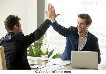 Businessman giving high five to partner, business achievement, t