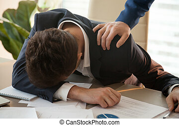 Tired businessman sleeping at workplace, male hand waking him up