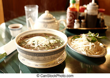 Vietnamese pho noodles with beef at a restaurant