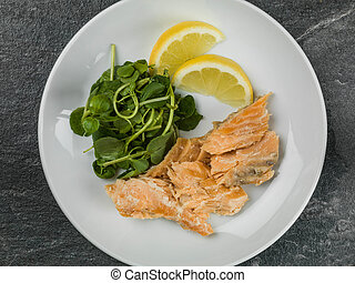 Poached Salmon and Watercress Salad Against a Black...