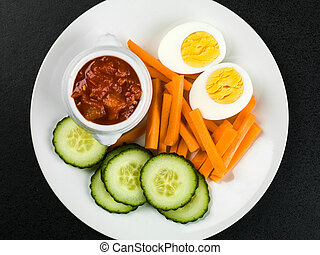 Egg Carrot and Cucumber Crudites With Tomato Salsa Against a...