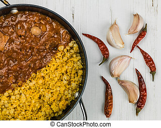 Lamb Tagine With Couscous and Chickpeas Against a White...
