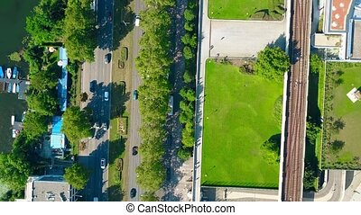 Aerial top down view of car road, boat berth and railroad on...