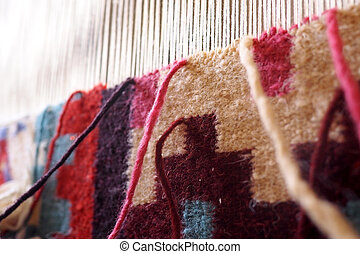 carpet being woven on a loom - carpet weaving on a loom