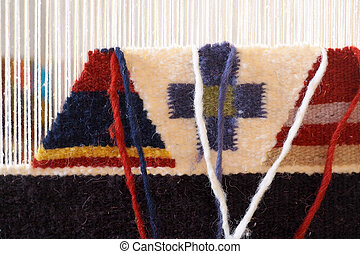 carpet being woven on a loom - carpet on a loom for weaving