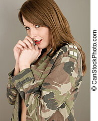 Portrait of a Woman Posing Pin Up Style in a Military...