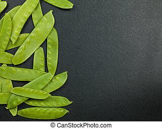 Mangetout or Mange Tout Peas - Fresh Uncooked Mangetout or...