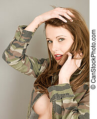 Young Woman Wearing an Army Camouflage Jacket in an Implied...