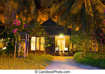 Beach bungalow at night - vacation background
