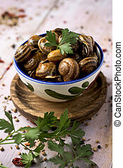 spanish caracoles en salsa, cooked snails in sauce - a...