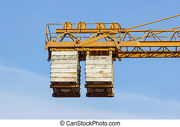 The counterweight of the tower crane at work .