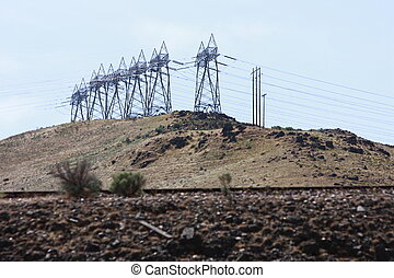 Powerlines on a hill.
