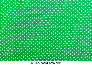 Green polka-dot cotton backdrop directly above.