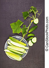 Sliced cucumber on saucer - Ripe organic cucumber with...