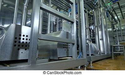 A dairy factory pipework, barrels and controllers. - A dairy...