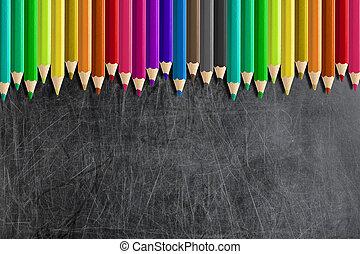 misaligned coloured pencils blank blackboard chalkboard -...