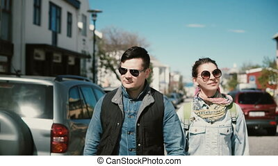 Young beautiful couple walking in the Reykjavik, Iceland and...