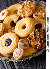 Assorted shortbread cookie close-up on a plate. vertical
