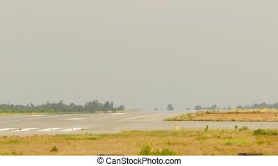 Passenger plane fly up over take-off runway from airport Hue...