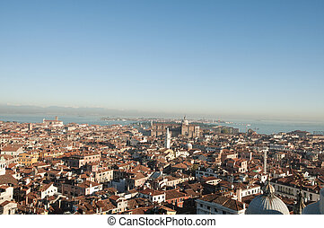 Ariel view of Venice with snow capped mountains in...