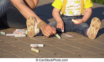 Children draw with crayons in Park.