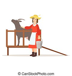Farmer woman milking her goat, farming and agriculture...