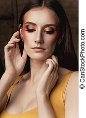 Fashion portrait of pretty brunette model with bright makeup