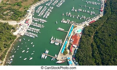 Aerial view of multiple parked boats, motorboats and...