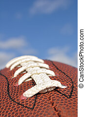 Close-up of American Football Texture and Laces with...