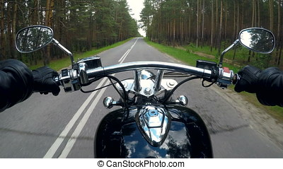 A POV biker shot riding in the country. - A POV shot on a...