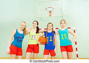 Happy girls after victory in basketball match
